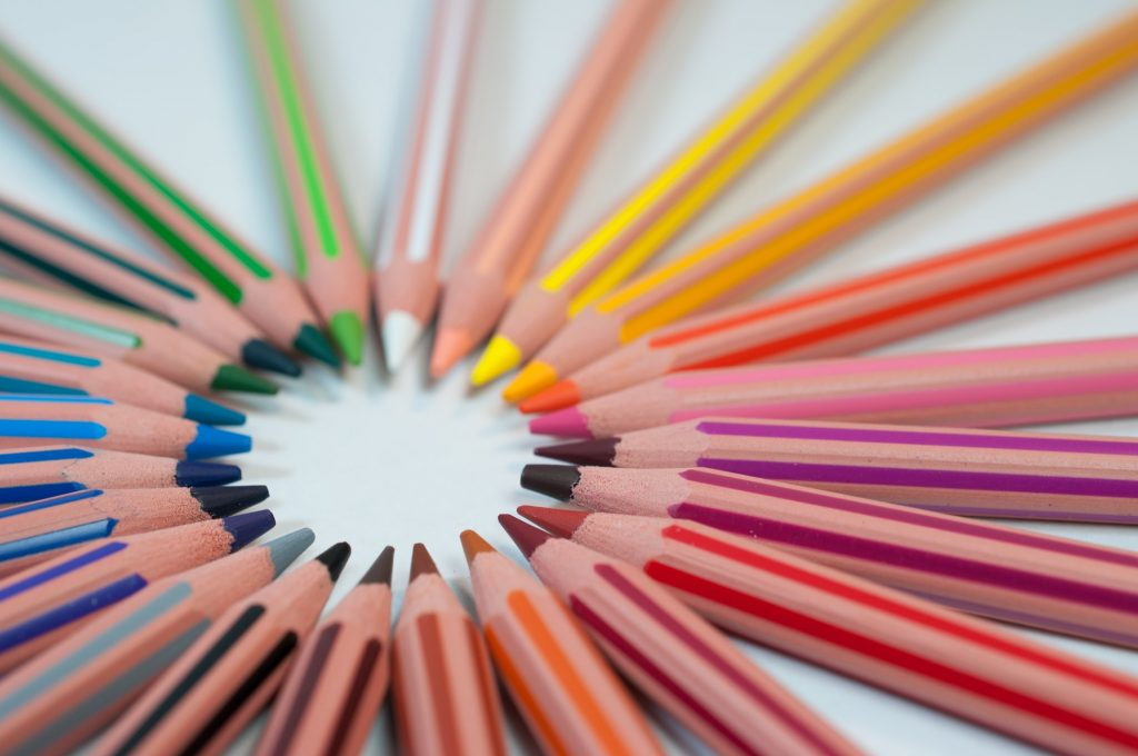 Coming up with article ideas. Photo of a circle of colored pencils. Photo credit: Agency Olloweb, via Unsplash.
