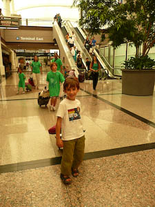 Homeward bound! my 6-year-old son pulls the luggage through the Denver airport after BlogHer 2010.