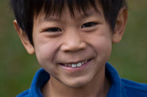 Close up of a first grade Asian American boy during a first grade photo shoot | photo by Jennifer Margulis