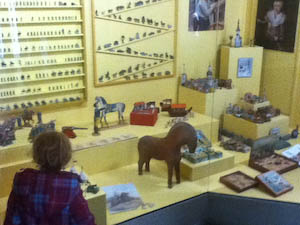 Leone liked looking at the old-fashioned Norwegian toys at the Norsk Folkemuseum where we tasted Norwegian flat bread for the first time | Jennifer Margulis