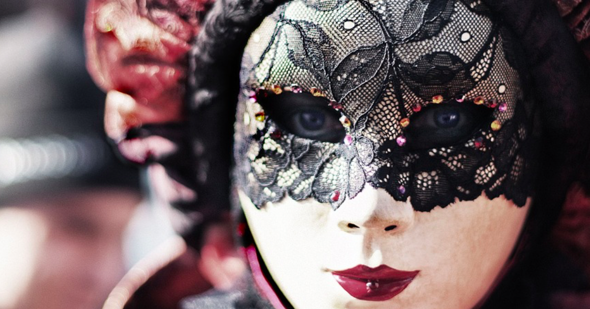 Writers experience imposter syndrome. A photo of a masked person at a carnival. Via Jennifer Margulis, Ph.D.