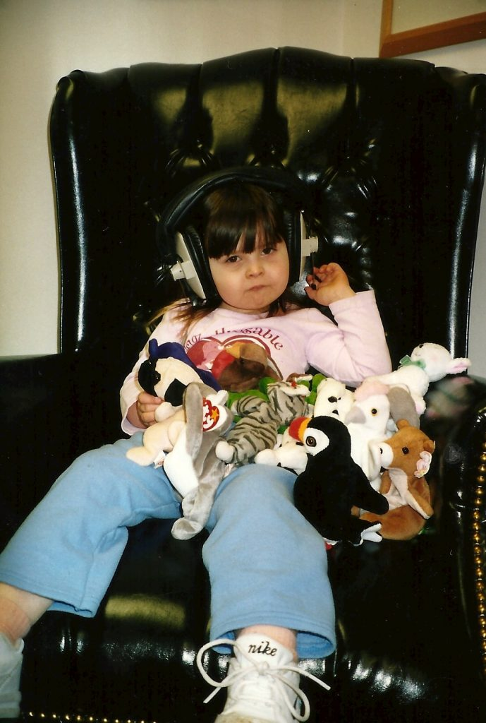 Riley, age 3, receiving Berard Auditory Training. Kids with autism often benefit from early intervention.