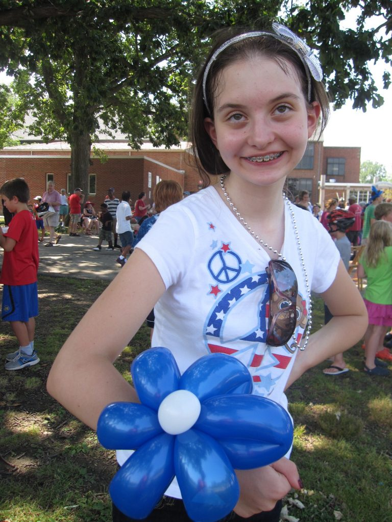 Riley, who has autism, posting for a photograph on July 4. Her mom, Michelle O'Neill, is an advocate for kids with autism.