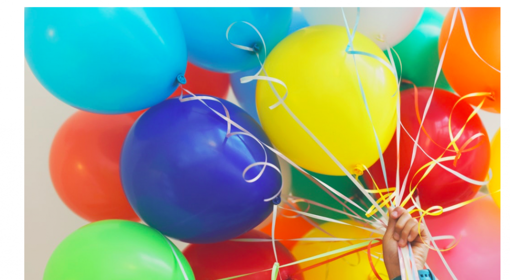 Do you know kids with autism? Have you ever invited a child with autism to your child's birthday party? Photo of a hand holding a bunch of colorful balloons.