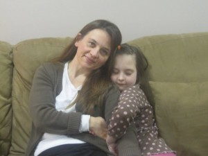 Michelle O'Neil and her daughter Riley, who has autism, when Riley was eight years old. Kids with autism and their families need our love and support.
