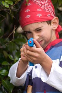 What to do about the parent-child personality clashes? Photo of a boy dressed like a pirate playing with a toy gun. Photo credit: Jennifer Margulis.