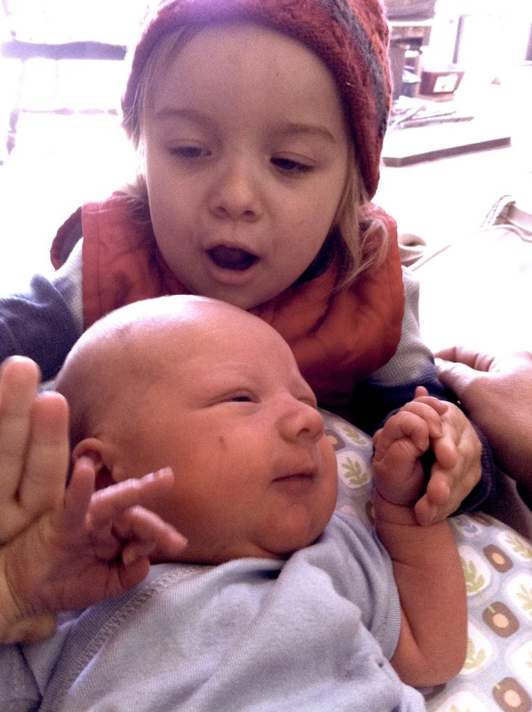The birth story of a sweet baby boy. Sierra with her baby brother who was born at home unassisted. Photo courtesy of Marisa Soboleski.