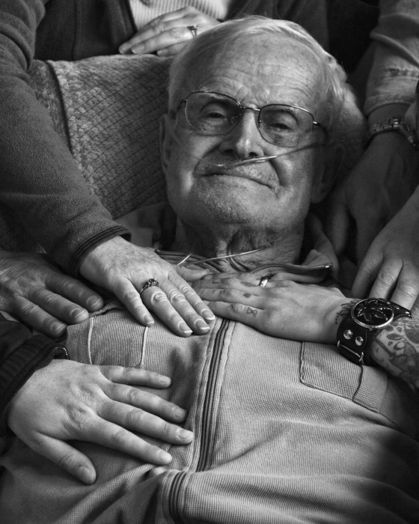 We all want a death with dignity. But how do we make sure that's what happens? A dying man is surrounded by loved ones. Photo courtesy of Mary Landberg.