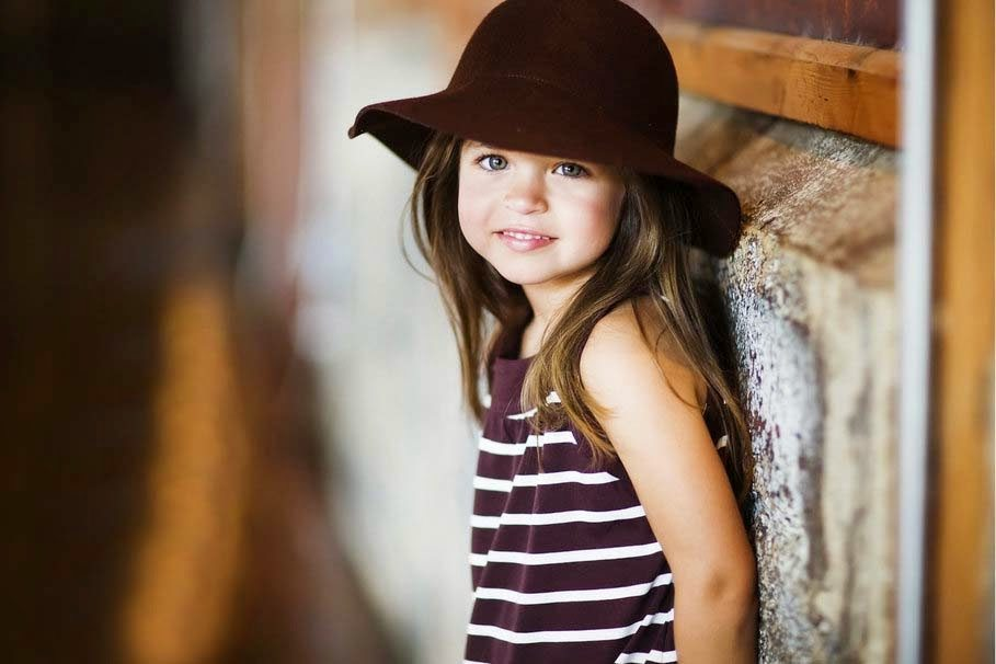 Make two lifestyle changes and never use antibiotics again. Via Jennifer Margulis, Ph.D. Photo of a girl with brown hair wearing a brown hat and brown and white striped shirt.