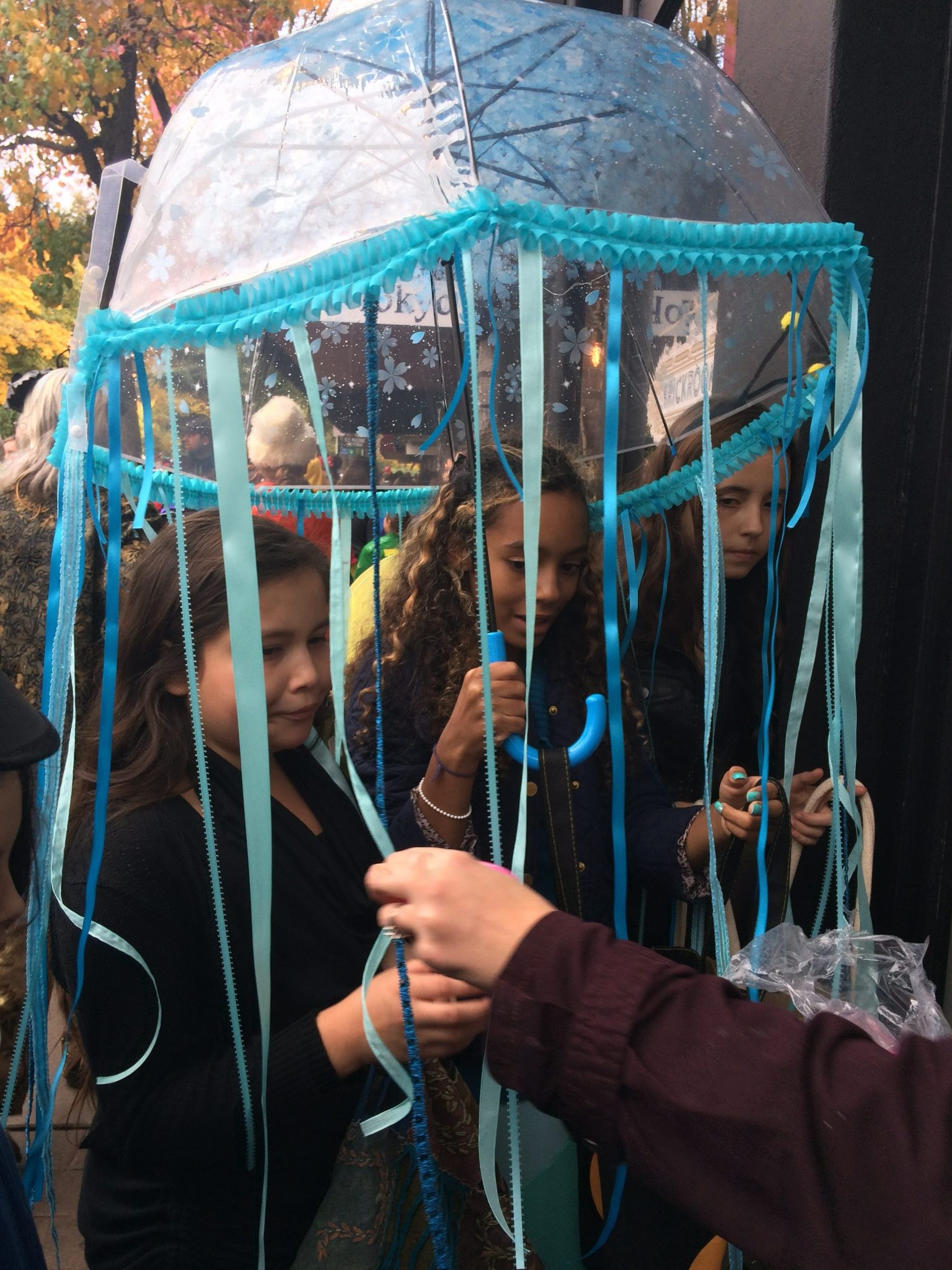 Jellyfish trick-or-treating on the Plaza in Ashland, Oregon during the Halloween parade