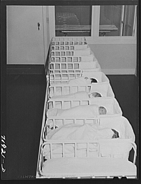 Newborns swaddled and sleeping alone in the nursery at the Cairns General Hospital Eleven Mile Corner, Arizona. Is it safe for babies to be alone? Photo via Library of Congress