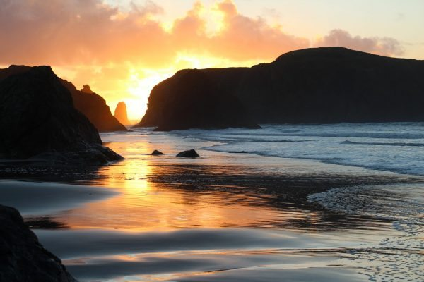 Sunset in Bandon by the Sea, Oregon seen during a writers' retreat. Photo by Sue Langston.