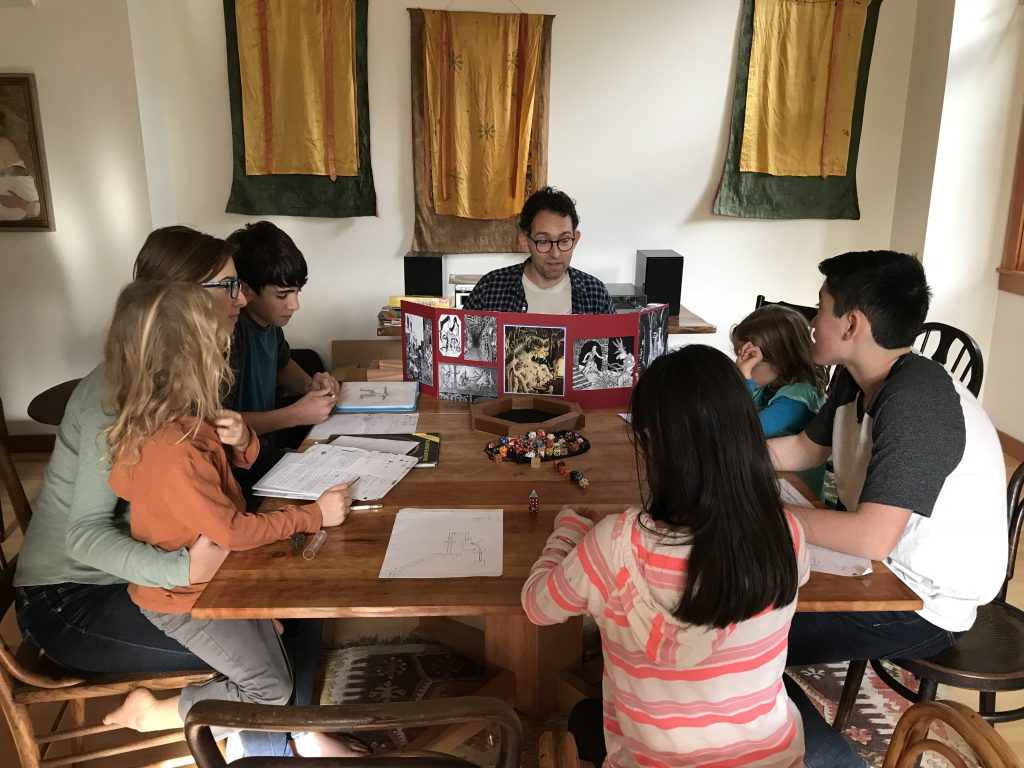 Children and teens playing Dungeons and Dragons at a happy Thanksgiving 2017. Photo via Jennifer Margulis