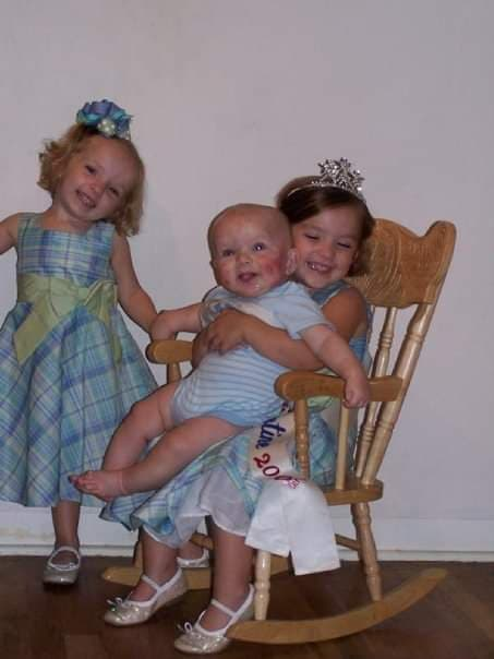 Baby Andante with his two adoring older sisters when severe eczema began appearing on his face and body. He has life-threatening allergies to airborne allergens.