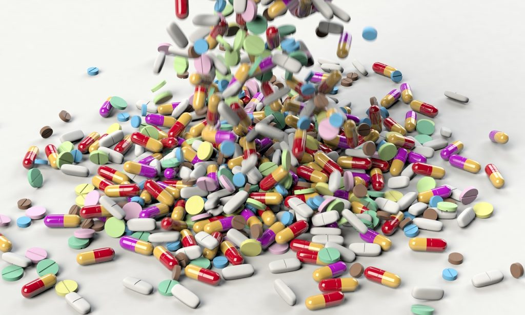 New study: Mice given influenza after taking antibiotics were more likely to die than mice not exposed to antibiotics. Antibiotics disrupt healthy gut bacteria | photo of a cascade of pills via JenniferMargulis.net