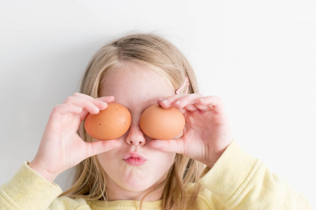 Love to cook 2. Photo of a little girl holding eggs courtesy of Hannah Tasker via Unsplash.