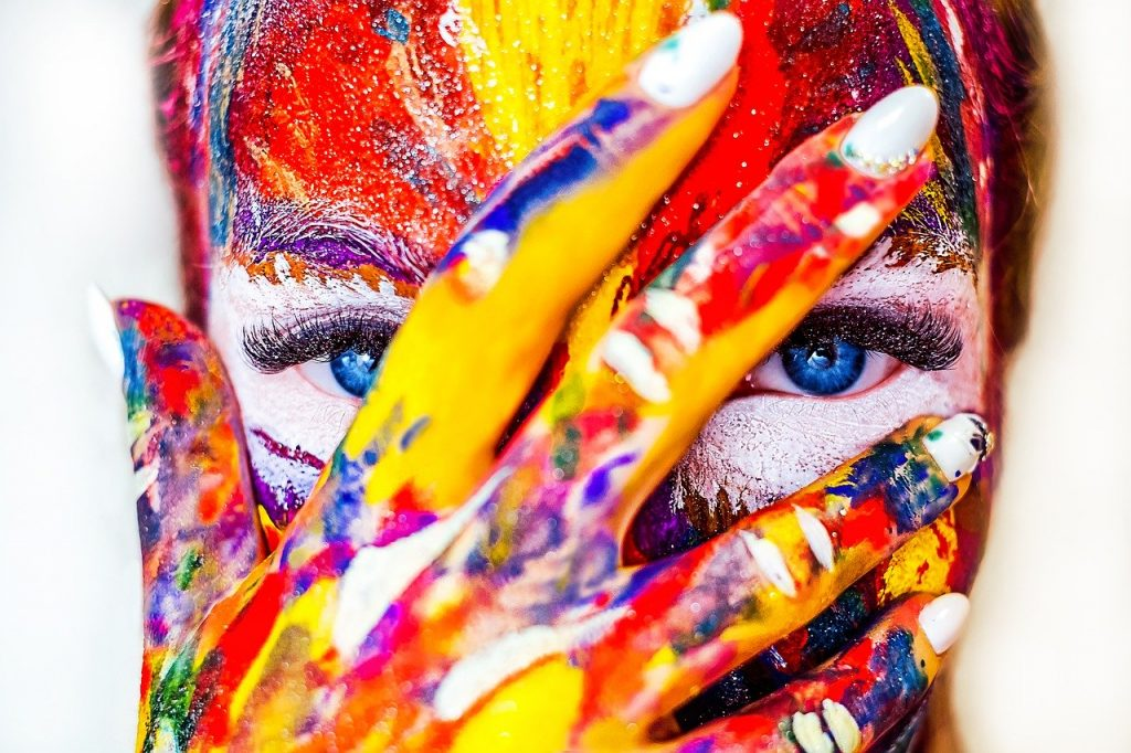 Avoid toxins. Here are 20 tips. Photo of a person covered in vibrant paint, courtesy of Pixabay. | Jennifer Margulis