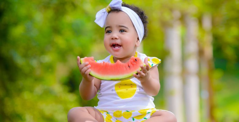 New study compares health outcomes in vaccinated and unvaccinated children. Photo of a baby in nature eating a slice of watermelon courtesy of Dazzle Jam via Pexels. | Jennifer Margulis, Ph.D.