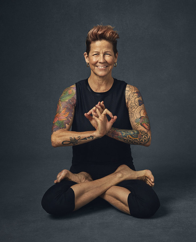 "A picture of feminine strength. Dana Trixie Flynn is a yogi who says ""vulnerability is really letting people see your heart--that's the most beautiful strength."" Photo by Sophy Holland. Courtesy of Gallery Books."