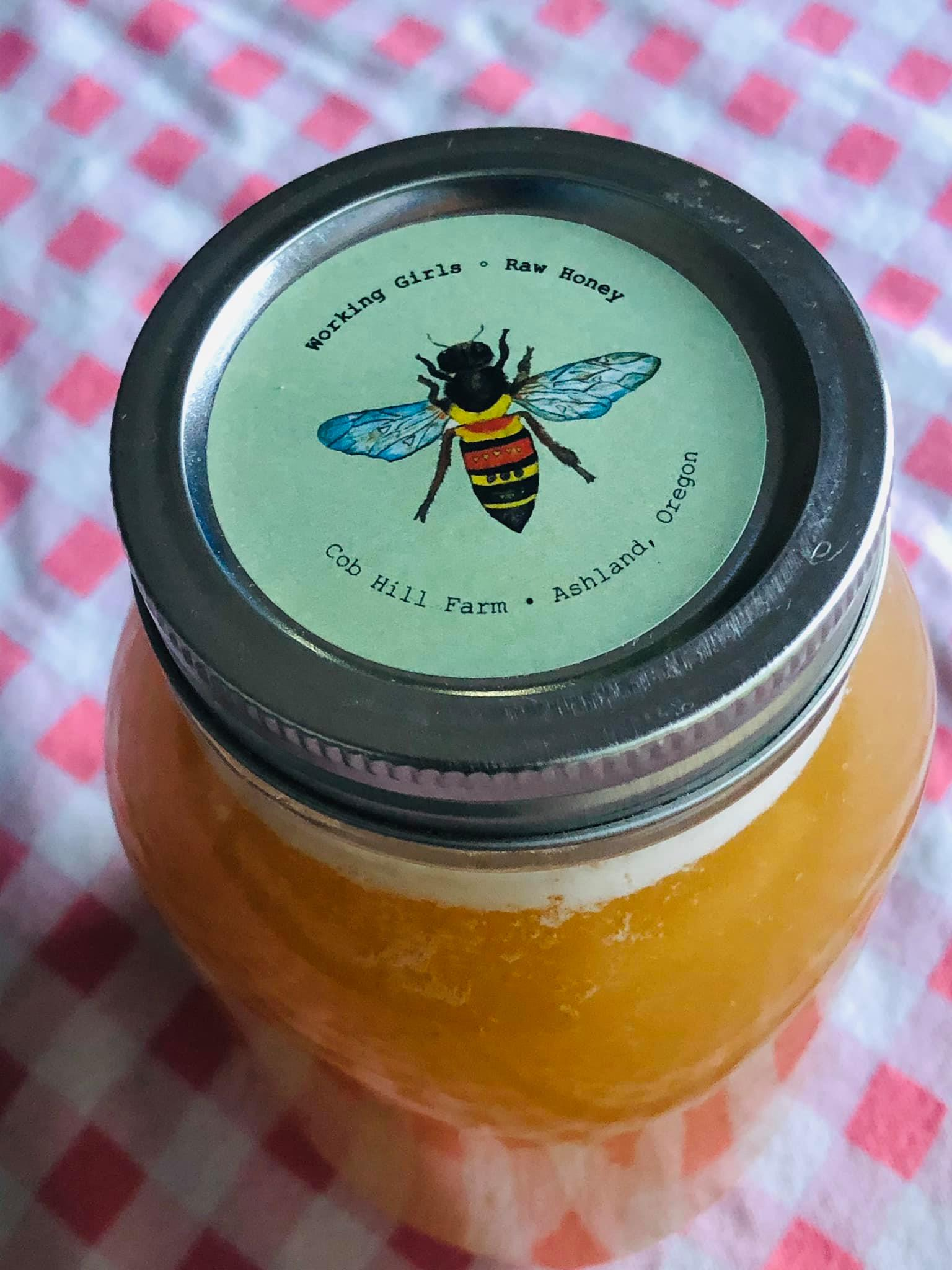 Glyphosate in honey, even organic honey, is a growing problem, according to several scientific studies. Photo of a jar of Working Girls Raw Honey with original art by Jennifer Margulis