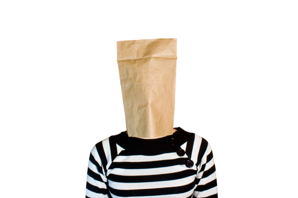 Coffee in a time of pregdemic. A tongue in cheek post by Jen Swann Downey. Photo of a person with a bag on her head wearing a black and white shirt. Via Jennifer Margulis, Ph.D.