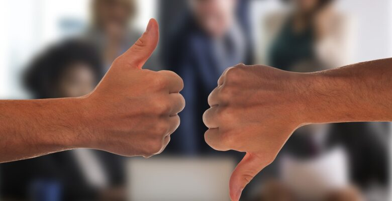 healthcare workers refusing covid vaccines, a medical doctor explains why. Photo of one hand with a thumbs up, one with a thumbs down. Courtesy of Pixabay. | Jennifer Margulis, Ph.D.