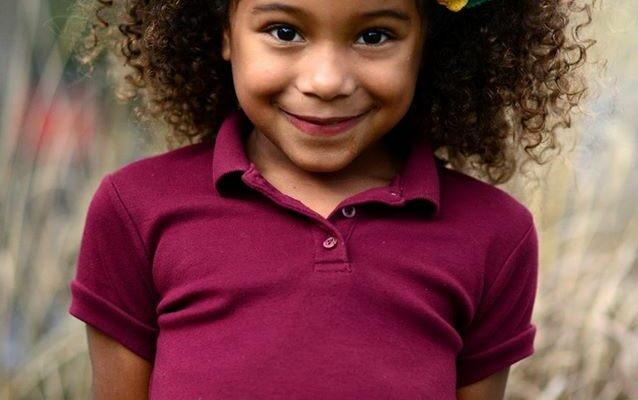 An African-American girl wearing a maroon shirt and a big smile. Felicia Leggio Braud photo. Unvaccinated children are healthier than their vaccinated counterparts. Why? | Jennifer Margulis, Ph.D.